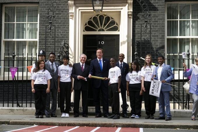 A delegation of children including Tanzanian representatives Mwajuma Babu and Frank Kapeta with the UK Prime Minister David Cameron at Downing Street no. 10 in London,  Global Hunger Summit in London, June 2013